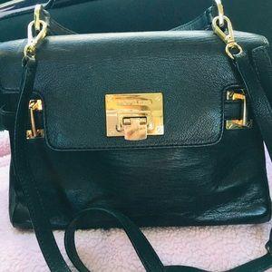 Two way Michael Kors  bag slightly used